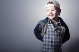 Smiling Child.Funny Little Boy in Jeans.Trucker cap.Denim Wear