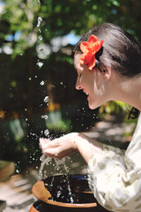 splashing fresh water on woman hands