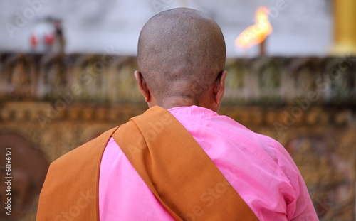 Buddhist nun praying at the Shwedagon Paya, Myanmar