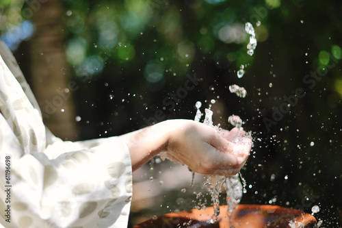 splashing fresh water on woman hands