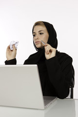 Arab Female Student Crumples & Throws A Piece Of Paper
