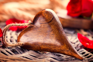 Valentine's Day. Wooden heart over wood background