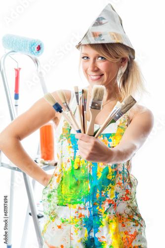 Leinwanddruck Bild Blonde Malerin mit Pinseln