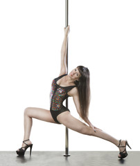 Slim professional pole dancer