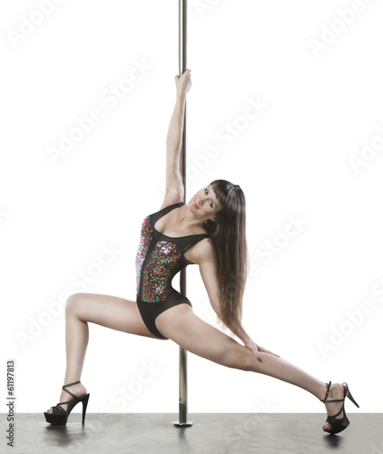 Slim professional pole dancer