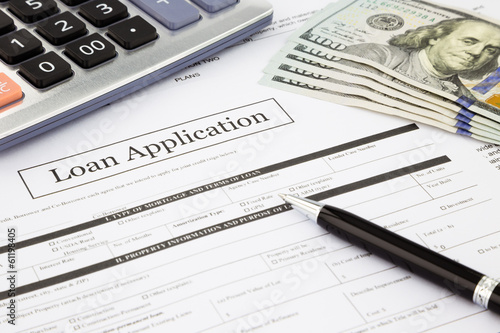 loan application form and dollar banknotes