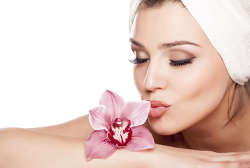 beautiful woman with a towel on her head and kissing orchid