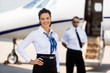 canvas print picture - Beautiful Airhostess With Hand On Hip At Airport Terminal