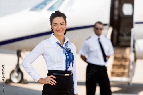 canvas print picture Beautiful Airhostess With Hand On Hip At Airport Terminal