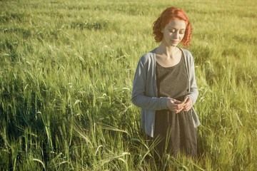 girl and green field in the morning
