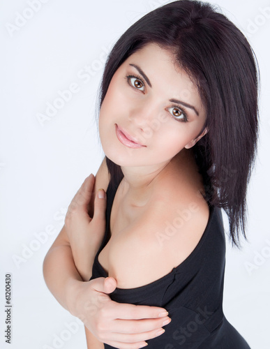 close portrait of a girl hugging herself a top view