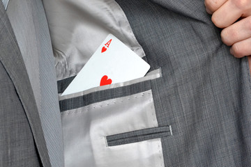 Man with ace in the pocket of the jacket