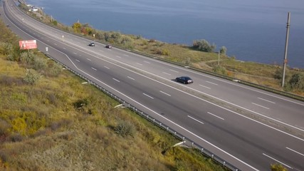 Aerial view. Highway along the sea. Bridge across the strait