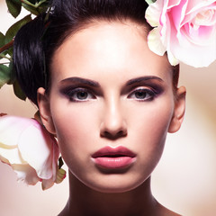 Beautiful fashion  woman with pink flowers in hairs