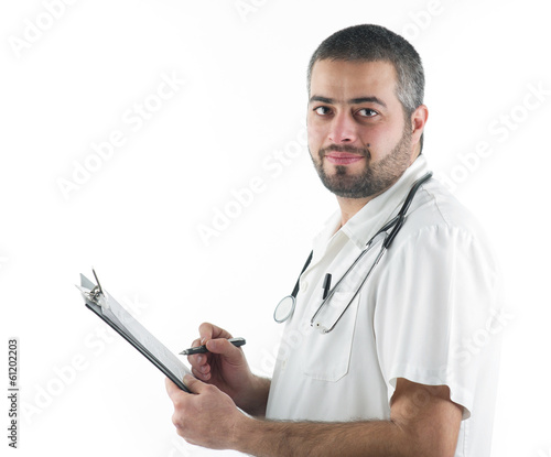 Doctor writing notes to a patient's folder isolated on white