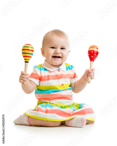 Baby girl playing with musical toys. Isolated on white backgroun