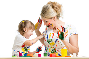 Mother with kid paint together