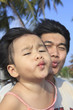 baby kid and father funny kissing mouth