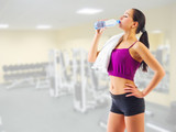 Young girl with water bottle at gym club