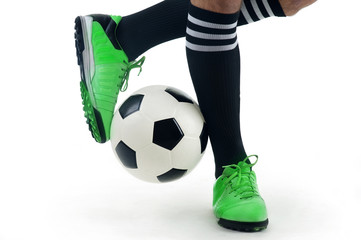 Close-up of a player's feet playing the ball
