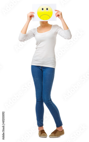 Young girl in jeans with sad poster