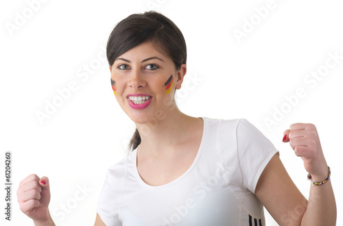 Young woman cheering for Germany with flags painted on her face