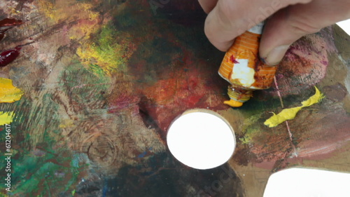 artist's oil colors palette over white