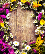 colorful floral frame on rustic wooden background