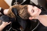 woman washing her hair in hairsalon poster