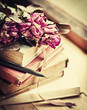 Vintage background with Roses on old books