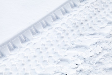 Background texture with  tire tracks on fresh snow