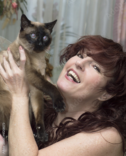 Portrait of the beautiful woman with a cat.