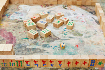 playing in mahjong board game by wooden tiles