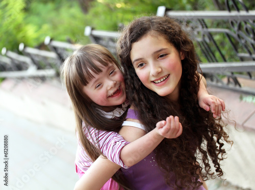 Happy girls in the park. - 61208880