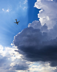 An Airliner, Blue Sky, Clouds and Sunbeams