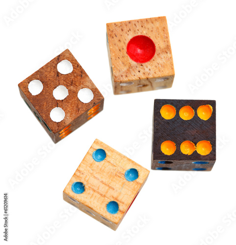 top view of four wooden gambling dices isolated