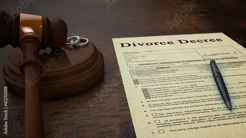 divorce decree paper with a pen, gavel and rings