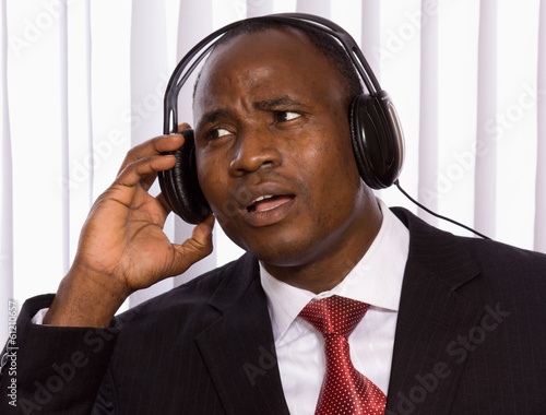 Portrait of a smiling Afro-American businessman with headset.