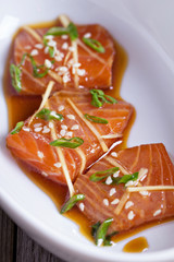 Salmon sashimi with ginger and sesame