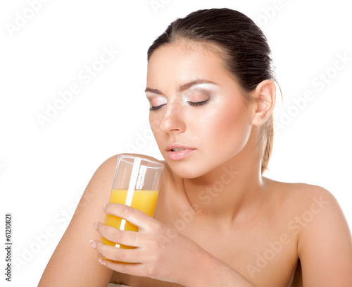 A young woman drinking orange juice