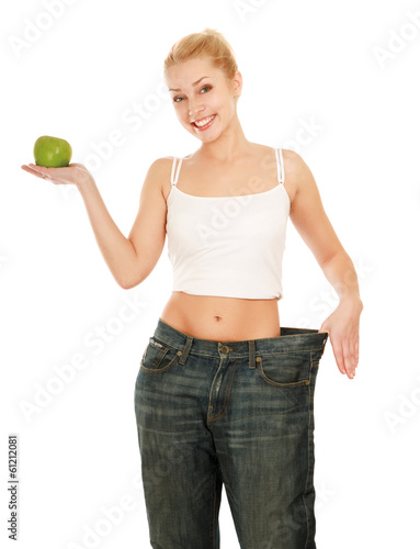 young girl with big jeans and apple