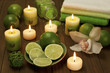 still life with limes and candles on a wooden board