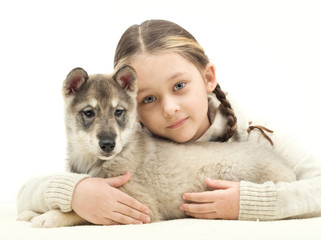 child hugging a puppy