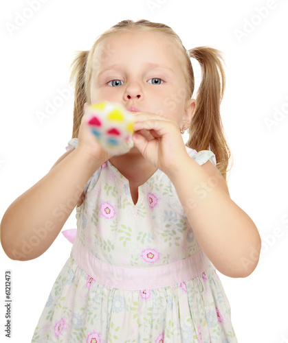 Cute little girl with blowouts toy.
