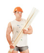 A man in orange hard hat wiyh a wood plank