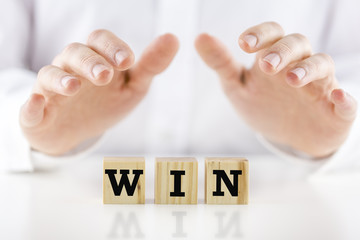 The word - Win - on wooden blocks