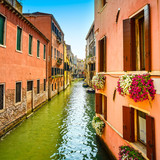 Venice cityscape, Cannaregio water canal, flowers and boats. Ita