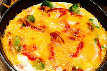 Oven Baked Skillet Eggs with Brocoli, Cheese and Sriracha Sauce