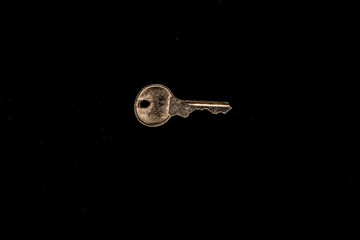 key isolated in black