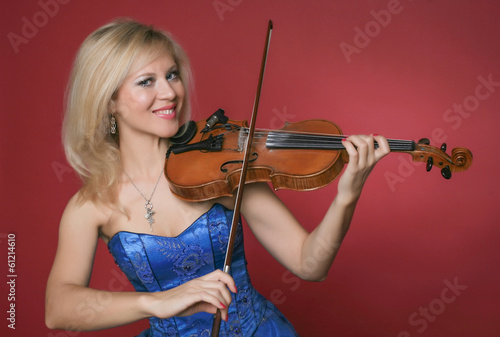 woman violinist in blue dress